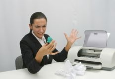 Business woman. Angry Business woman is trying to install ink cartridge in printer royalty free stock photography