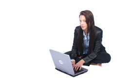 Business Woman. Woman on Laptop Looking At Camera royalty free stock image