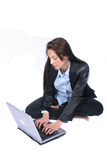 Business Woman. Woman on Laptop Not Smiling royalty free stock photography