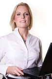 Business woman. Woman with pc is smiling Royalty Free Stock Images