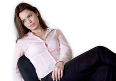 Business woman. Brunette lady is sitting relaxed in her chair royalty free stock images