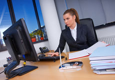 Business woman. In office working on computer Stock Photo