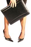 Business woman. Close up of leg of woman and briefcase royalty free stock images