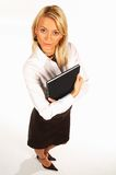 Business Woman 2. Business women isolated on white holding black book royalty free stock photography
