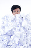 Business woman. Behind a pile of crumpled paper Royalty Free Stock Image