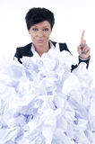 Business woman. Behind a pile of crumpled paper Royalty Free Stock Photography