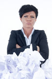 Business woman. Behind a pile of crumpled paper Royalty Free Stock Images