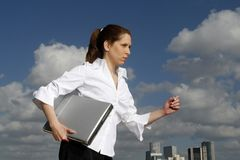 Business woman. And her laptop. blue skies in the background Stock Photo