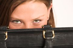 Business Woman #209(GS). Business woman hiding behind a black leather suitcase Stock Image