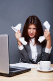Business woman. A depressed woman holding in her hands crumpled paper. Sitting at her office royalty free stock photo