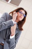 Business woman. Beautiful business woman on the phone at modern building. Outdoors royalty free stock photo