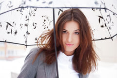 Business woman. Young business woman holding umbrella while walking outdoors in winter royalty free stock photography