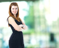 Business woman. A portrait of a young business woman in an office Stock Photography