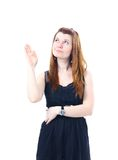 Business woman. A young beautiful business woman pointing at copyspace Stock Image