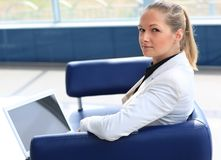 Business woman. Portrait of beautiful business woman using laptop while looking at you Royalty Free Stock Photography