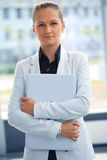 Business woman. Posing with laptop Royalty Free Stock Image