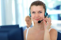 Business woman. Female customer support operator with headset and smiling Royalty Free Stock Images