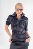 Business woman. Wearing glasses over a white background royalty free stock image