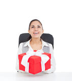 Business woman. Happy smile excited, sitting with red gift box, look up to empty copy space, isolated over white background Stock Photo
