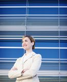 Business woman. Standing with smile in front of a modern business building Stock Images