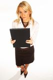 Business Woman 3. Business women isolated on white holding black book royalty free stock image