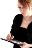 Business woman. Strawberry Blond business woman holding a clipboard Stock Images