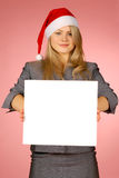 Business-woman. The girl in New Year's  cap Royalty Free Stock Images