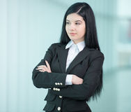 Business Woman. Successful business woman looking confident and smiling Royalty Free Stock Photography