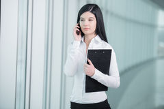 Business Woman. Smiling businesswoman talking on the phone Stock Image