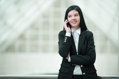 Business Woman. Smiling businesswoman talking on the phone Royalty Free Stock Images