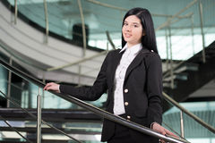 Business Woman. Successful business woman looking confident and smiling Royalty Free Stock Photo