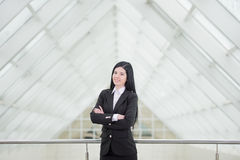 Business Woman. Successful business woman looking confident and smiling Stock Photo