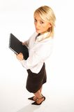 Business Woman 4. Business women isolated on white holding black book royalty free stock photo