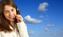 Business woman. Smiling pretty business woman with headset Royalty Free Stock Photos