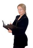 Business woman. With a notepad wearing glasses Stock Photo