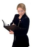 Business woman. With a notepad wearing glasses Stock Photography