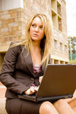 Business Woman. Beautiful young univercity student typing on her laptop Royalty Free Stock Image