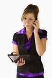 Business Woman. Talking on cellular phone and organiser in hand Royalty Free Stock Photos