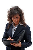 Business woman. Woman writing the dossier royalty free stock images