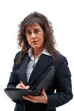 Business woman. Woman writing the dossier royalty free stock photography