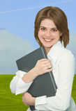 Business woman. On a background sky and grass Royalty Free Stock Photos