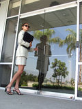 Business Woman 965. Business Woman Executive in suit with briefcase entering business offices Royalty Free Stock Photography