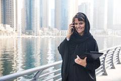 Business woman in an abaya. Professional business woman in a traditional emirati abaya Royalty Free Stock Image