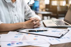 Business woman accountant working audit and calculating expense stock images