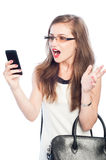 Business woman acting amazed while checking smartphone Royalty Free Stock Images