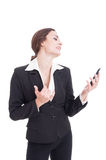 Business woman acting sexy on a video call. Using smartphone and opening her shirt Royalty Free Stock Images