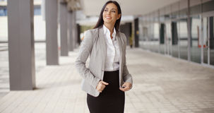 Business woman adjusting her hair outdoors Stock Photos