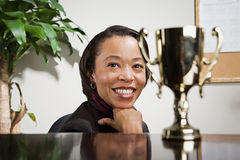 Business woman admiring her trophy. Business women admiring her trophy royalty free stock photo