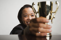 Business woman admiring her trophy. Business women admiring her trophy stock photography