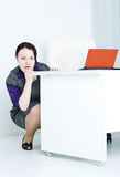 Business woman afraid. Business woman hiding behind table and afraid Royalty Free Stock Image